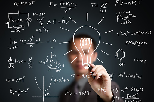Teacher writing a science formula