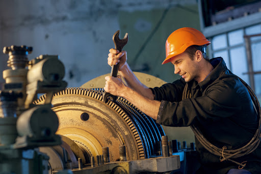 Worker works on the repair plant