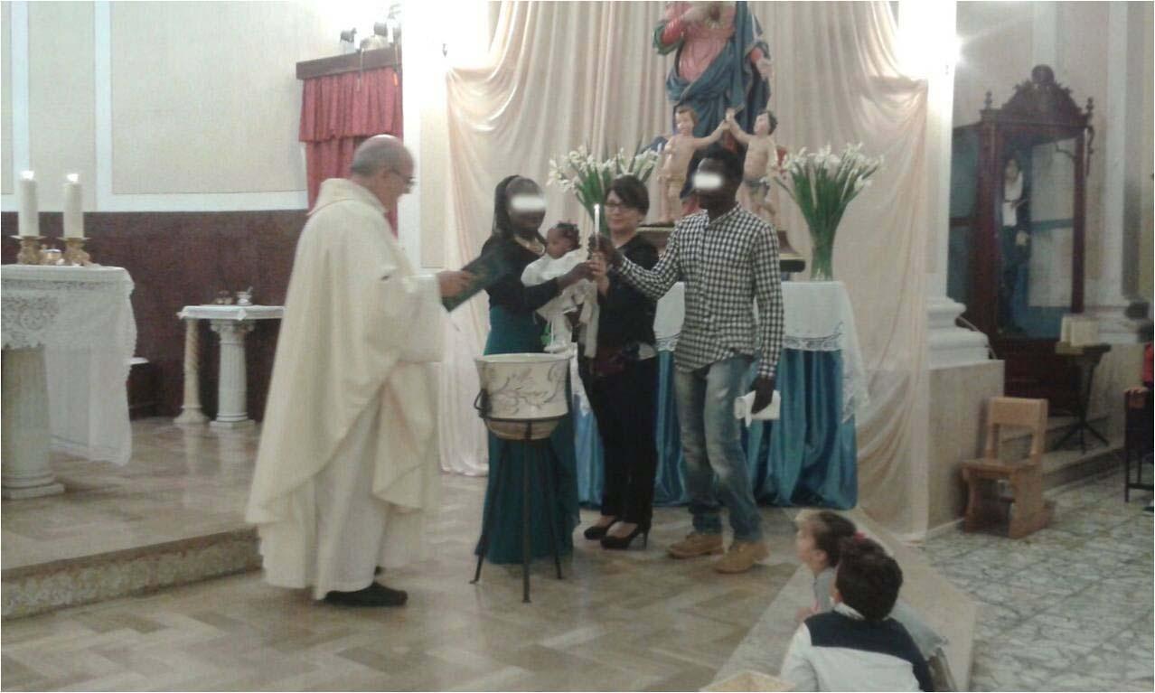 battesimo bimbo rifugiato