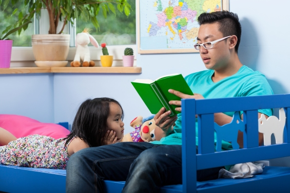 Asian daughter listening a fairytale at home © Photographee.eu / shutterstock_206422414