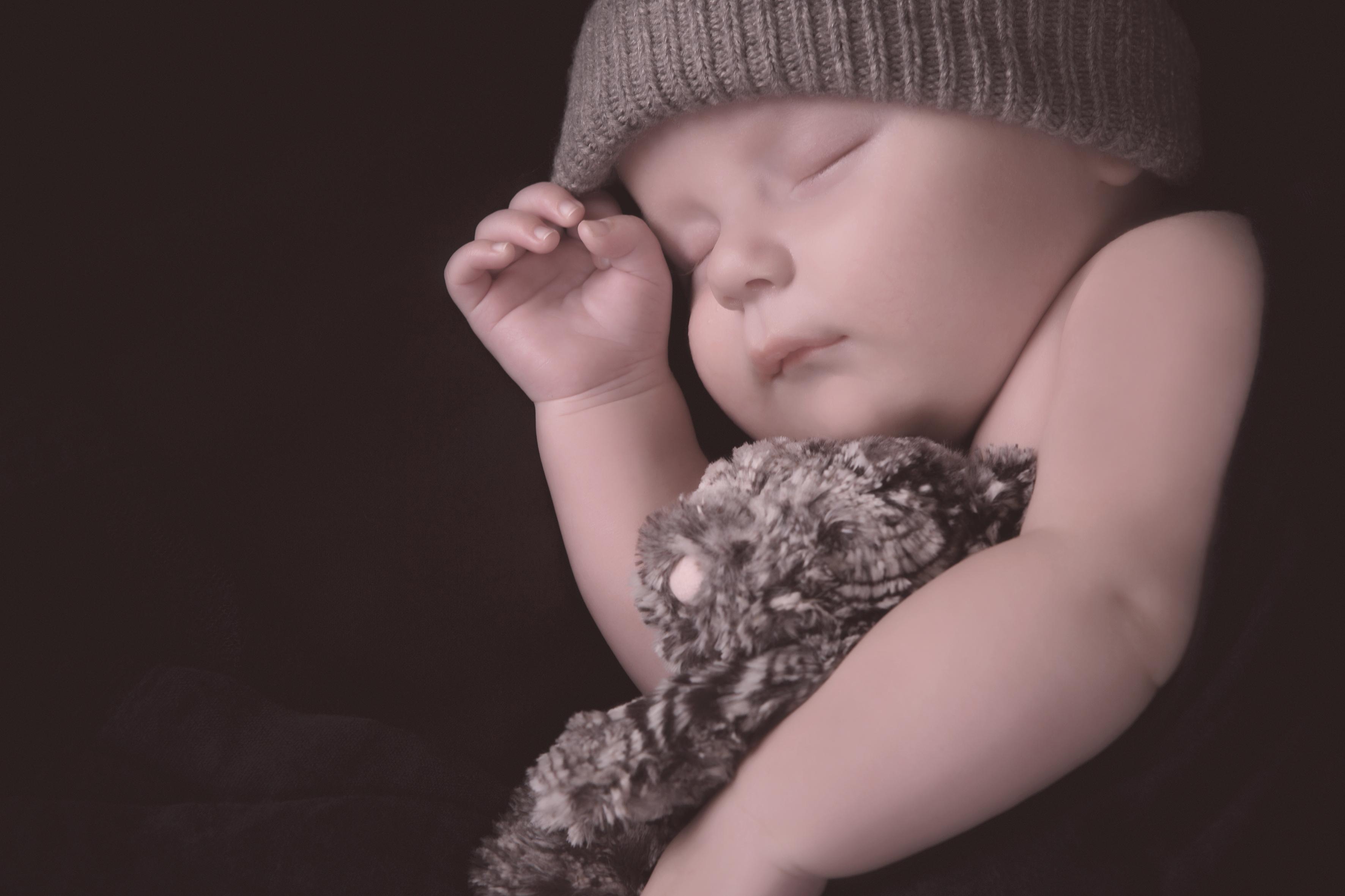Studio shot of a newborn boy sleeping © Kjersti Joergensen shutterstock_322907045