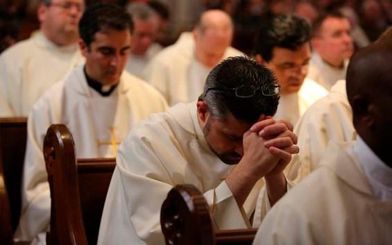 Priest pray
