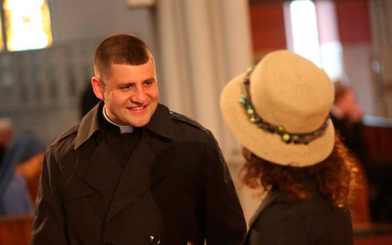 Priest talking with woman