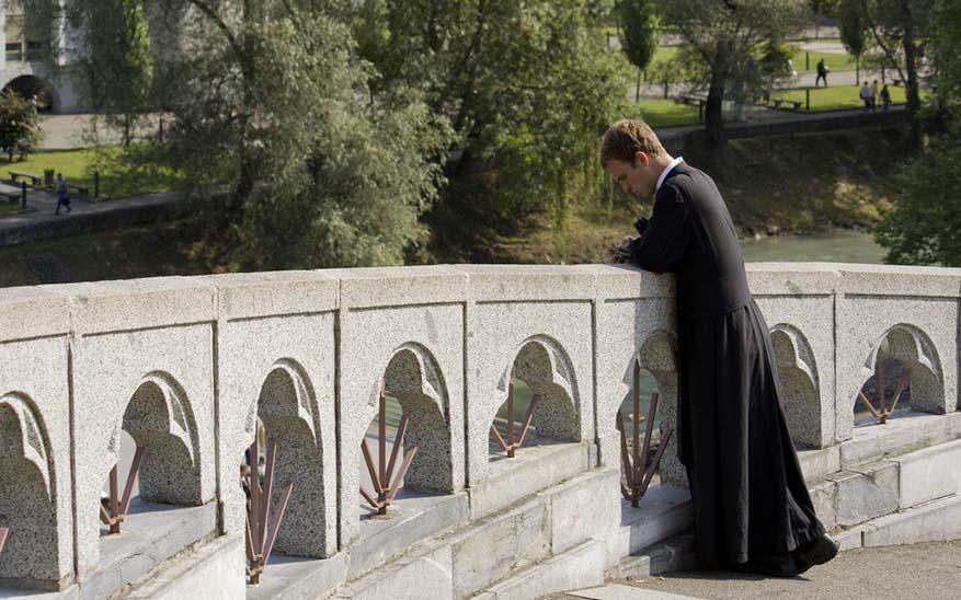 Priest on the bridge