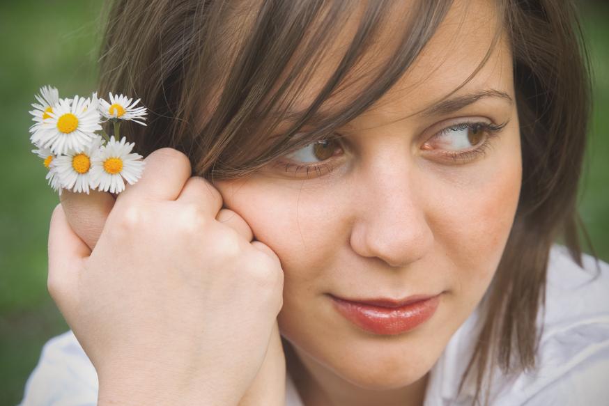 web-girl-young-woman-gazing-flowers-ivan-mateev-shutterstock_312156893