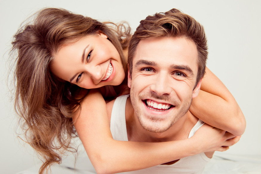 web-married-couple-happy-laugh-young-shutterstock_367776410-roman-samborskyi-ai
