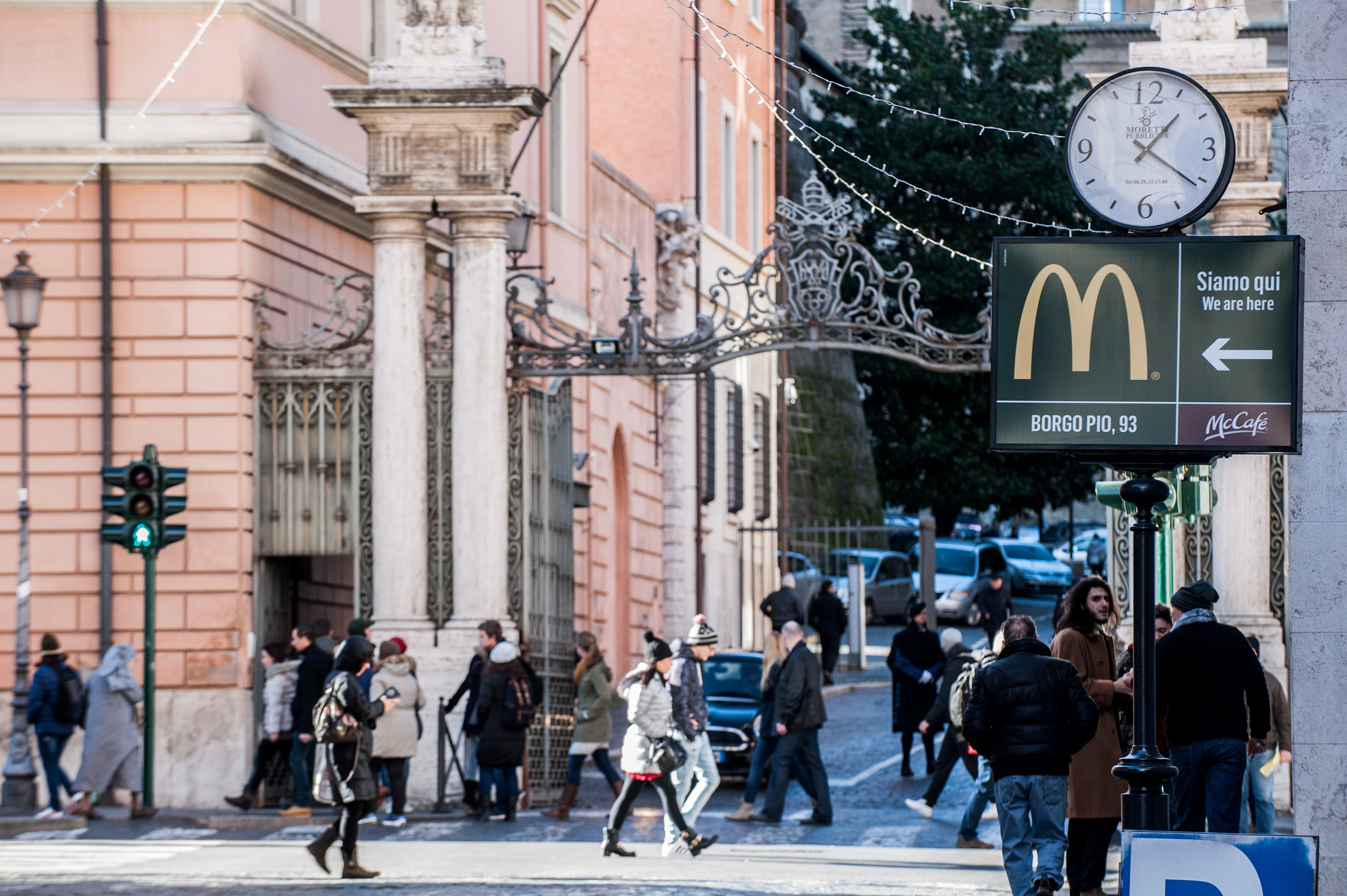 January 5 2017 : A sign showing the direction of a McDonald restaurant is seen near an entrance of the Vatican in the background.