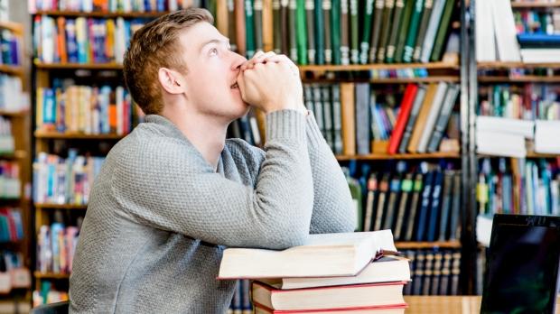 STUDENT PRAYING,LIBRARY