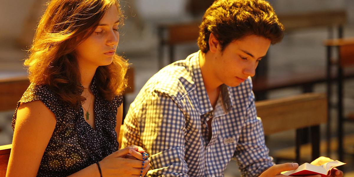 Teenagers praying