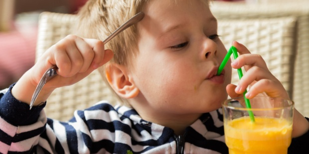 CHILD,DRINKING,ORANGE,JUICE