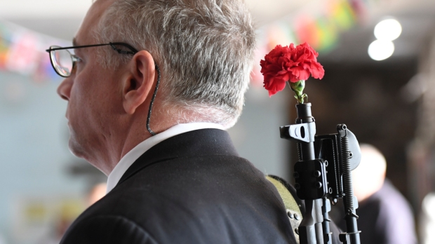 WORSHIPPERS AT WORLD PEACE AND UNIFICATION SANCTUARY HOLD WEAPONS