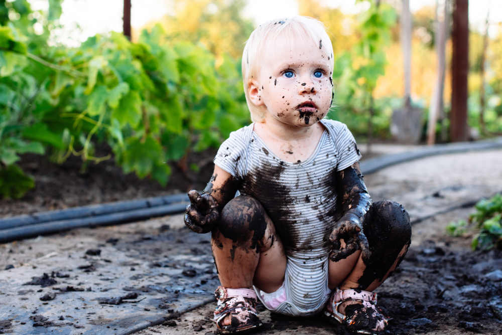 CHILD, BLUE EYES, MUD