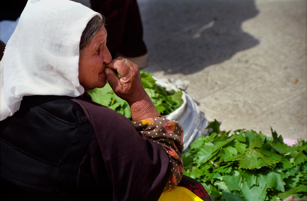 OLD WOMAN, JERUSALEM, SELLING