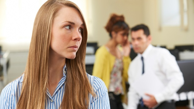 woman Being Gossiped About By Colleagues