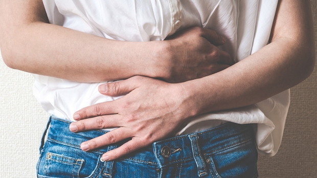 WOMAN HOLING STOMACH