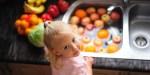LITTLE GIRL WASHING FRUIT