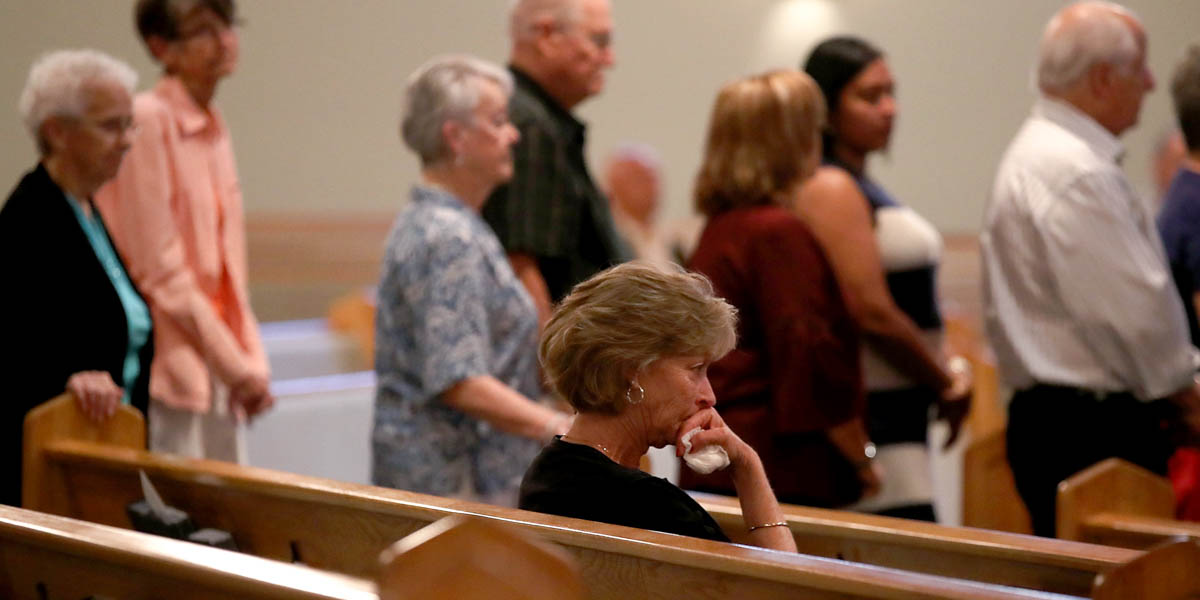 COMMUNION LINE,WOMAN SITTING IN PEW
