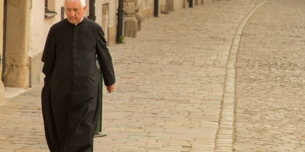 PRIEST WALKING