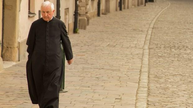 PRIEST WALKING