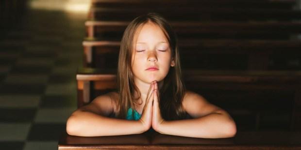 YOUNG GIRL,PRAYING,CHURCH PEW