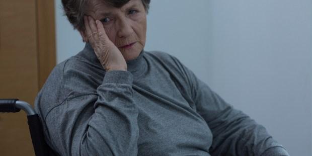 aged sad woman wheelchair