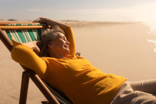WOMAN, BEACH, SUN