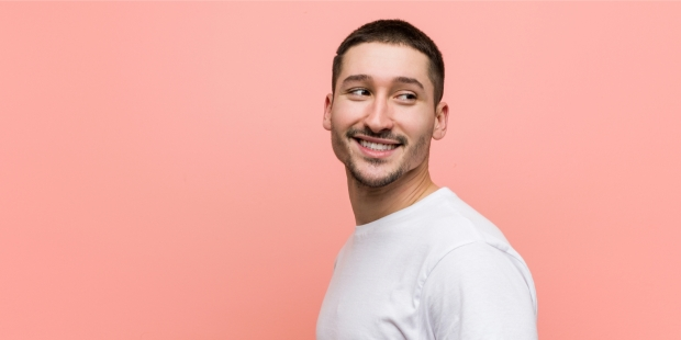 young casual man smiling