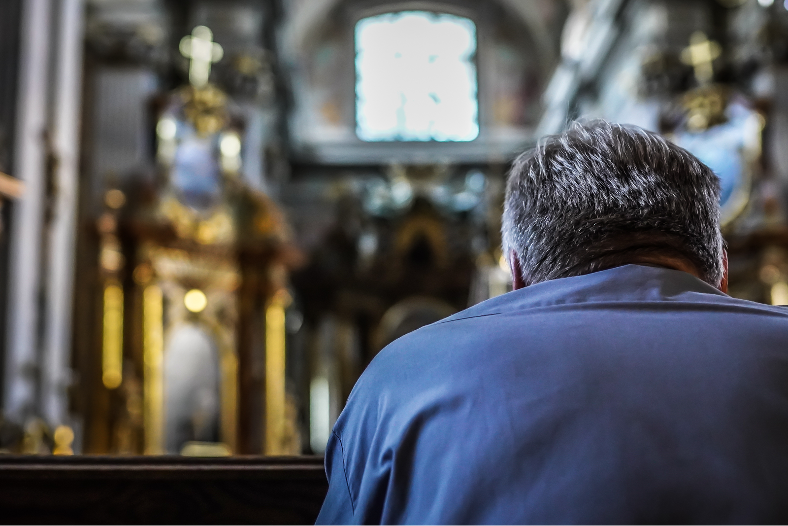 man praying in a church