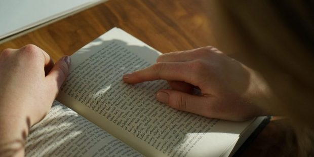 HAND, BOOK, WOMAN