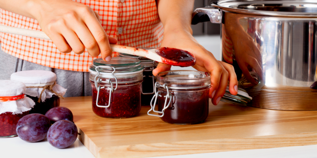 woman making fruit jam