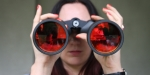 WOMAN, BINOCULARS, RED