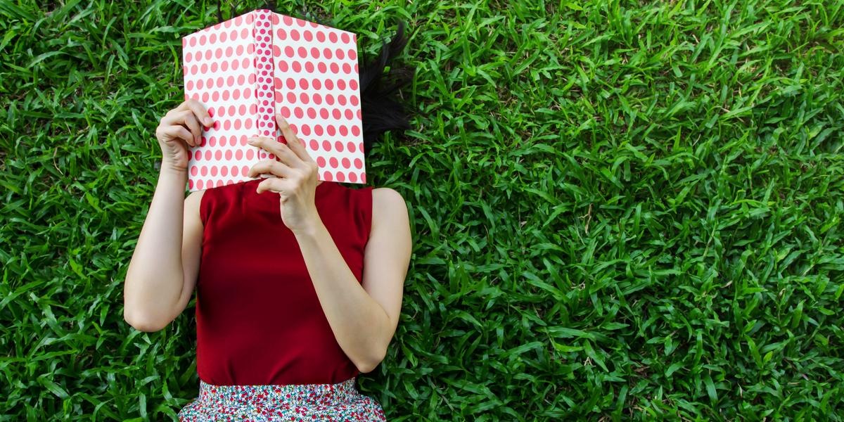 WOMAN, BOOK, GRASS