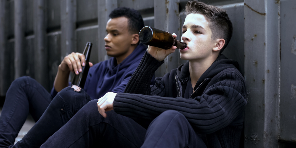 teenager guys drinking beer