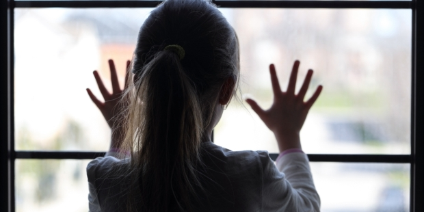young girl at window