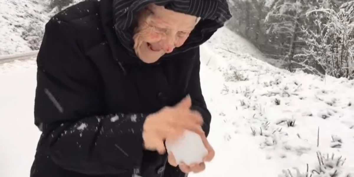 OLD WOMAN, PLAYING, SNOW