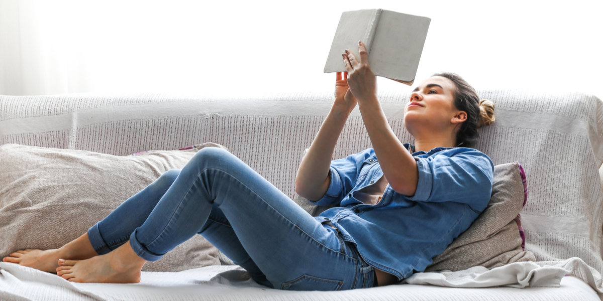 WOMAN, READING, SOFA