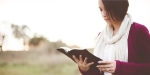WOMAN READS the Bible,