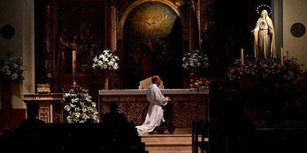 PRIEST PRAYING