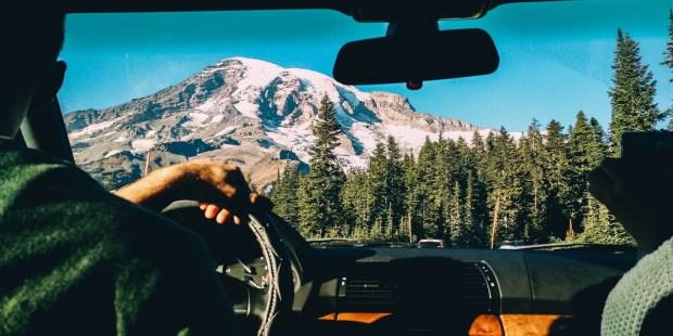 MAN, DRIVING, MOUNTAINS