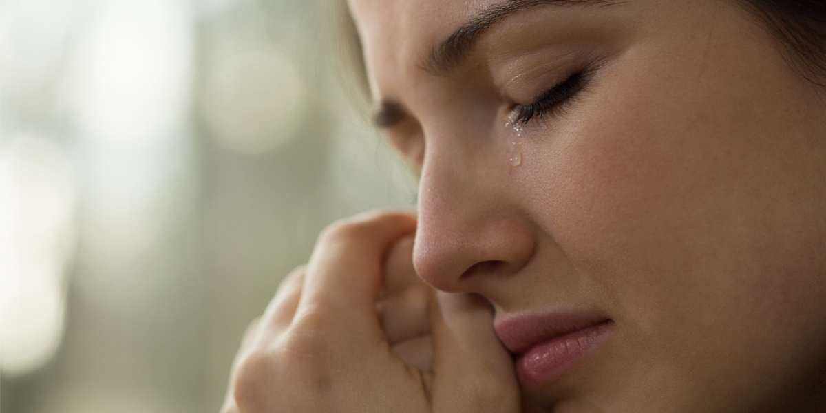 WOMAN CRYING,