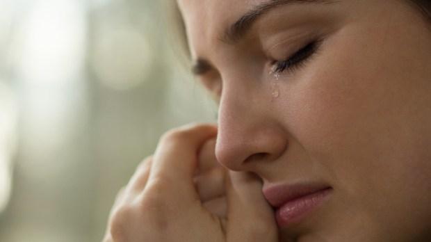 WOMAN CRYING,