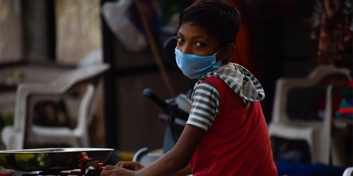 INDIAN BOY WITH MEDICAL MASK,