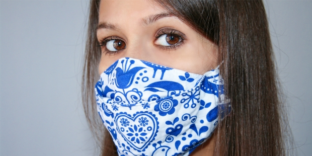 YOUN WOMAN WITH MEDICAL MASK,