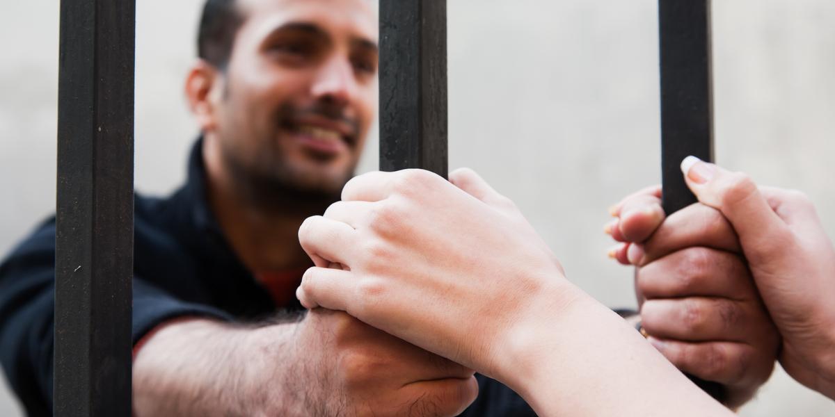 PRISON, MAN, WIFE HANDS