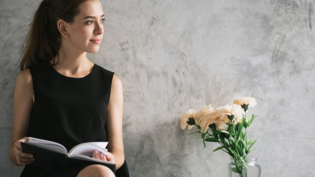 WOMAN, BOOK, FLOWERS