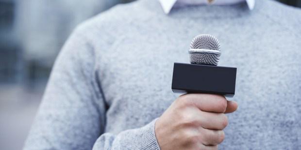 MAN, MICROPHONE, SPEAKING