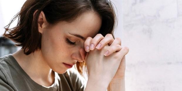 WOMAN PRAYS,
