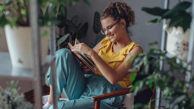 WOMAN READS BOOK,