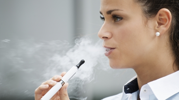 WOMAN SMOKES,