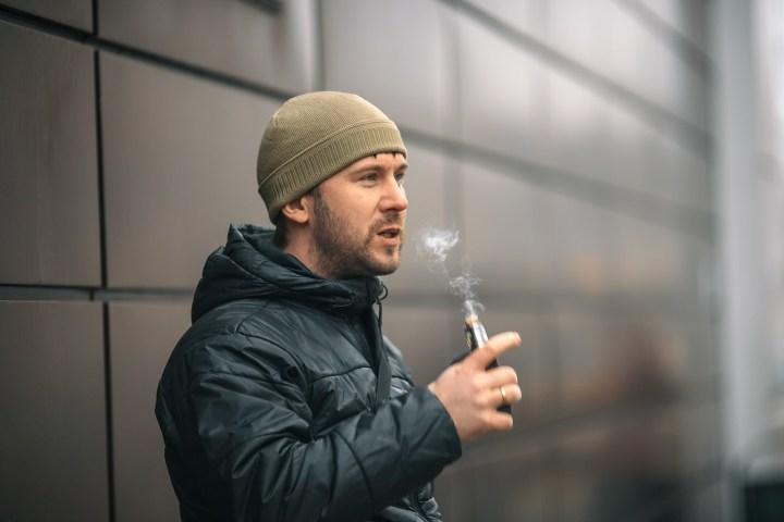 MAN SMOKES,